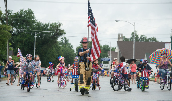 Globe/Roger Nomer<br /> Carl Junction firefighter Harvey Kitzberger leads the Carl Junction Fourth of July Parade on Tuesday in downtown Carl Junction.