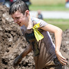 Jusrtice Waldo, 9, smiles from ear-to-ear as he Austin Miles, 11, of Webb City, emerges from a mud pit during Mudstock on Saturday in Carthage. The annual event is a drug awareness program sponsored by the Alliance of Southwest Missouri, with a course designed by Carthage Fire Department, Carthage Police Department, and the Carthage Caring Communities Coalition.<br /> Globe | Laurie Sisk