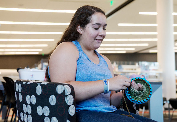 Globe/Roger Nomer<br /> Zoe Weston, 15, works on a hat for Chase the Chill on Monday at the Joplin Public Library.