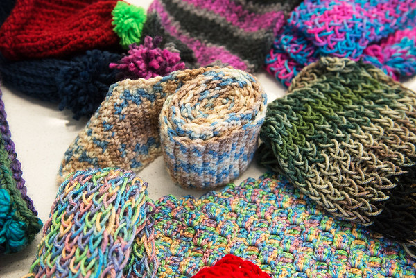 Globe/Roger Nomer<br /> Teens at the Joplin Public Library have knitted items for the Chase the Chill program.