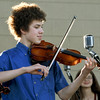 "Violinist Brady Farr entertains the crowd woth his group, the Saline Fiddlers Philharmonic during the ""Fiddlers on the Route"" music Festival on Saturday night at Landreth Park. The Connect2Culture event featured the Saline, Mi.-based group along with food and games for the children.<br /> Globe 