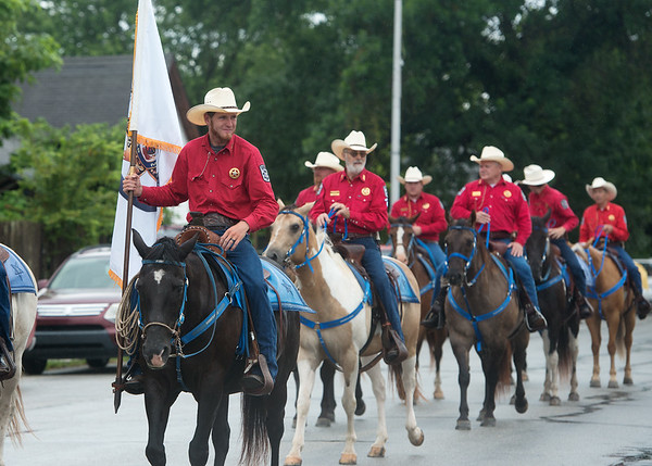 Globe/Roger Nomer<br /> Members of the Jasper County Sheriffs Department ride in the Carl Junction Fourth of July Parade on Tuesday.