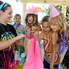 Renna Bray, center, gets a sneak peak at some birthday presents as she celebrates her eighth birthday with family and friends on Wednesday at Schifferdecker Park. Joing Bray, from the left: Her mother, Samanatha Decker, grandmother, Lupe Daniels, Jordan Daniels, 12 and Jayda Daniels, 7.<br /> Globe | Laurie Sisk