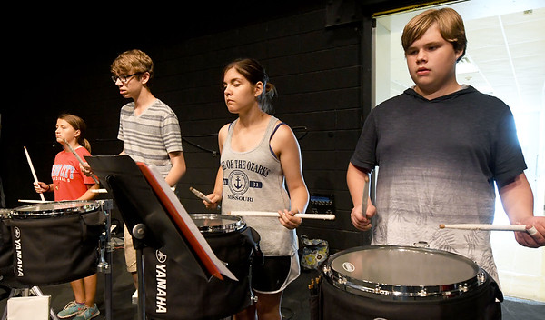 From the left: Webb City High School students Madison Holly, 14, Josh Witte, 17, Anna Struble, 15 and Max Fisher, 14, rehearse with the Cardinal Pride Marching Band on Wednesday at WCHS. The band will be premiering their 2017 season on Friday at Cardinal Stadium.<br /> Globe | Laurie Sisk