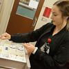 Globe/Roger Nomer<br /> Taylor Price, a RN in the Cardiac Medical Unit, checks medicine on Wednesday at Freeman Hospital.
