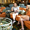 From the left: Eleven-year-old twins Kiera and Kylie Mayer and their sister Macey Mayer, 16, enjoy video games in the lobby of Homewood Suites by Hilton befor their Texas Sliders first game of the Premier Baseball Tournament on Wednesday morning. The girls, who are daughters of Skiders coach xxx Mayer, have been coming to Joplin for the tournament most of their lives and said they look forward to it each year.<br /> Globe | Laurie Sisk