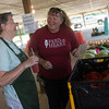 Globe/Roger Nomer<br /> Eileen Nichols talks with Missy Jones, food ministry coordinator, as she shops on Thursday at the Webb City Farmers Market.