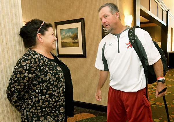 Arkansas Prospects coach Shane Fullerton chats with Homewood Suites by Hilton Manager Denise DuBois before departing for his team's first game of the Premier Baseball Tournament at Homewood Suites by Hilton on Wednesday morning.<br /> Globe | Laurie Sisk
