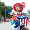 Globe/Roger Nomer<br /> Nolan Burns, 7, pauses with his hand over his heart for the National Anthem during the Carl Junction Fourth of July Parade in downtown Carl Junction.