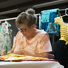 Lynda DuMond tags blue ribbon exhibits for competition at the Ozark Empire Fair on Wednesday at the Newton County Fair.<br /> Globe | Roger Nomer