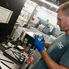 Patrick Roush, machinist, works at CNC Machine Products on Friday.<br /> Globe | Roger Nomer