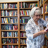 Pauline McGuire looks at books in the new library of the Joplin Senior Center on Monday.<br /> Globe | Roger Nomer