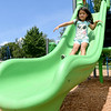 Vanessa Estrada, 3, checks out one of the new slides at Neosho's Scenic Park on Friday during a grand opening for the park. Crews have installed new equipment and refurbished existing equipment at the park.<br /> Globe | Laurie Sisk