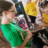 Jolee Montague, 2, pets Jazmyne Deither's goat Thunder on Wednesday at the Jasper County Youth Fair.<br /> Globe | Roger Nomer