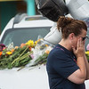 Michelle Howard, St. Louis, wipes away tears after praying beside cars left in the parking lot of Ride the Ducks Branson on Friday.<br /> Globe | Roger Nomer