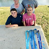 Eighteen-year-old distance runner and Special Olympian Brett Harper, lower right, poses with his family on Wednesday at King Jack Park. Pictured are Harper's brother, William Harper, 13, his mother, Sheila Harper and father, Bill Harper.<br /> Globe | Laurie SIsk