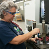 Michelle Evans, machine operator, works at CNC Machine Products on Friday.<br /> Globe | Roger Nomer