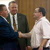 James Horton, Adriaunna Horton's father, shakes hands with Kevin Zoellner, assistant attorney general, left, and Steven Kaderly, Barton County prosecuter, following Friday's sentencing at the Barton County Courthouse.<br /> Globe | Roger Nomer