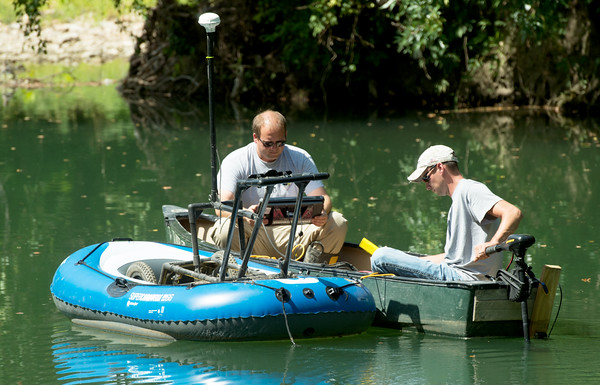 Officials from the Missouri Department of Natural Resources on Wednesday morning use sonar in a pond southwest of Lone Elm and Zora roads to try and locate the body of Tracy Pickett, who was presumed murdered in 1992.<br /> Globe | Laurie Sisk