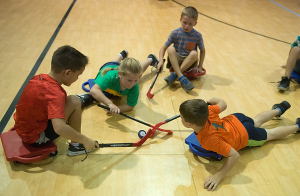 (from left) Johnathan Tilton, 8, Bailey Hamilton, 6, Emery Prater, 6, and Andrew Baird, 8, play a game at the Boys and Girls Club of Southwest Missouri on Monday.<br /> Globe   Roger Nomer