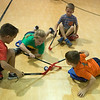 (from left) Johnathan Tilton, 8, Bailey Hamilton, 6, Emery Prater, 6, and Andrew Baird, 8, play a game at the Boys and Girls Club of Southwest Missouri on Monday.<br /> Globe | Roger Nomer