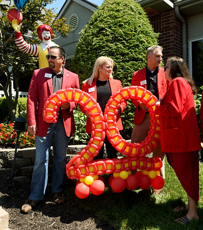 Members of the Joplin Area Chamber of Commerce hold a large balloon sculpture in celebration of the Ronald McDonald House's 20th Birthday on Friday at RMH.<br /> Globe | Laurie Sisk