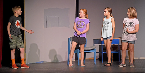 """From the left: Thatcher Girouard, Via Dennis, Anne Marie Wright and Amethyst Ogle rehearse their roles for the upcoming Jopln Little Theatre children's production of """"Bulldog Saves the Day,"""" a Vaudeville extravaganza and melodrama, which opens July 25 and runs through July 29 at JLT.<br /> Globe 