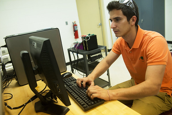 Silvio Arguello, a Missouri Southern senior from Nicaragua, works at the Missouri Center for Advanced Power Systems on July 16 at MSSU.<br /> Globe   Roger Nomer