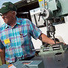 John Pitzer performs a demonstration on Friday at the Four State Farm Show in Pittsburg. <br /> Globe | Roger Nomer
