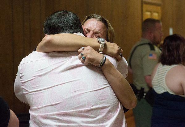 Wendy Jackson, Adriaunna Horton's mother, hugs James Horton, Adriaunna' father, following the sentencing of Bobby Bourne on Friday at the Barton County Courthouse.<br /> Globe | Roger Nomer
