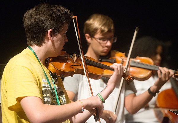 Jeremy Ward, 16, Oklahoma City, left, and Riley Ziegler, 18, Winfield, Kan., practice with the Next Generation Performing Arts Camp on Wednesday at Missouri Southern.<br /> Globe | Roger Nomer