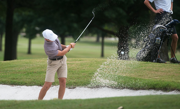 Bronson Smith, Nevada, hits out of a sand trap on Thursday at Twin Hills.<br /> Globe | Roger Nomer