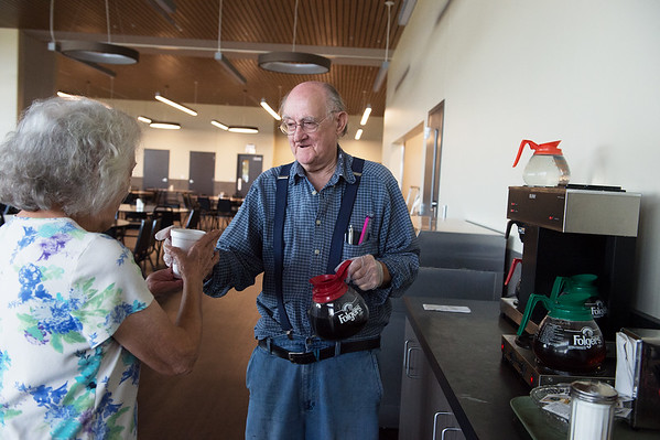 Bill Hawkins makes a cup of coffee for Jane Ashley on Monday at the new Joplin Senior Center. Hawkins has prepared drinks at the center for a long time, and made the transition to the new building.<br /> Globe   Roger Nomer