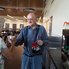 Bill Hawkins makes a cup of coffee for Jane Ashley on Monday at the new Joplin Senior Center. Hawkins has prepared drinks at the center for a long time, and made the transition to the new building.<br /> Globe | Roger Nomer