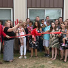 The ribbon is cut on the Ewert Park Early Head Start building on Wednesday.<br /> Globe | Roger Nomer