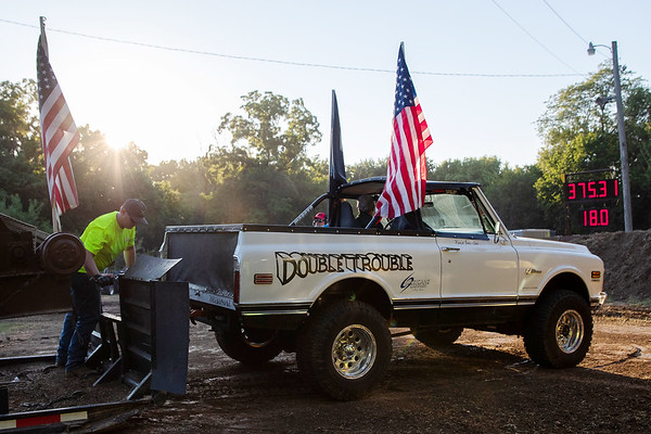 """Kenny Adams on board of the """"Double Trouble"""" a 1970 Chevy finishes the pull with top speed of 18 MPH during the tractor and pickup pull fund raiser sponsored by Carthage Shrine Club on Saturday evening.<br /> Israel Perez