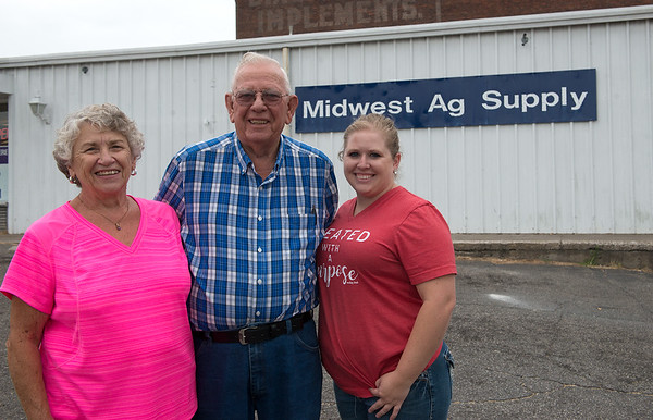 Donna and Dale Wickstrom are pictured with their daughter Erin Woody at Midwest Ag Supply in Carthage on Thursday.<br /> Globe   Roger Nomer