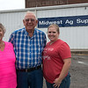 Donna and Dale Wickstrom are pictured with their daughter Erin Woody at Midwest Ag Supply in Carthage on Thursday.<br /> Globe | Roger Nomer