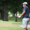 Chris Pryor, Joplin, chips onto the green on Thursday at Twin Hills Golf Course.<br /> Globe | Roger Nomer