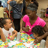 Kaylynn, 5, Brittany and Carter, 2, Rhea, Pittsburg, make an elephant craft during storytime at the Pittsburg Public Library on Wednesday.<br /> Globe | Roger Nomer