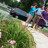 Julie Yockey, Carthage Library director, right, gives a tour of the Library gardens to Kristin Pategas and Devereaux Bemis on Thursday in Carthage.<br /> Globe | Roger Nomer