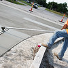 Bob Larson works on a concrete project in Carl Junction on Friday morning.<br /> Globe | Roger Nomer