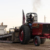 Russell Wagner on board of his 3588 International ready to start his pull during the tractor and pickup pull fund raiser sponsored by Carthage Shrine Club on Saturday evening.<br /> Israel Perez|Globe