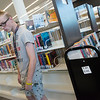 Jacob Plowman browses books at the Joplin Public Library on Tuesday.<br /> Globe | Roger Nomer