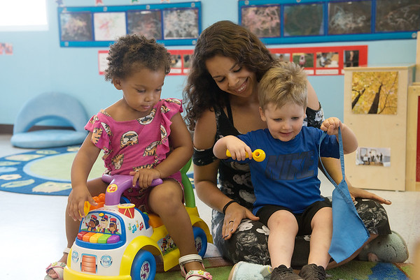 Maria Cervantes, lead teacher, plays with Arreyana Johnson, 2, and Grier Hill, 2, on Wednesday at the Ewert Park Early Head Start building.<br /> Globe   Roger Nomer