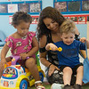 Maria Cervantes, lead teacher, plays with Arreyana Johnson, 2, and Grier Hill, 2, on Wednesday at the Ewert Park Early Head Start building.<br /> Globe | Roger Nomer