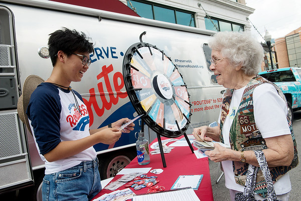 Charlyn Hubbard, Carterville, right, shares a postcard with Lina Tran, roadie with the National Trust for Historic Preservation during a visit on Tuesday at Joplin City Hall.<br /> Globe | Roger Nomer