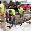 A crew from Sprouls Construction, Inc., installs islands in a parking lot as construction continues on the Block 22 project on Thursday in downtown Pittsburg.<br /> Globe | Laurie Sisk