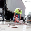 Rodney Garringer, of Sproul's Construction, Inc., prepares a side walk for installation of a handicap ramp as construction continues on the Block 22 project on Thursday in downtown Pittsburg.<br /> Globe | Laurie Sisk