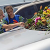 Kamryn Collier, 14, left, and Erin McMaster, 13, from Hope, Ark., place flowers on a car at the Ride the Ducks attraction in Branson on Friday.<br /> Globe | Roger Nomer